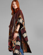 MAXI KNITTED PONCHO WITH CARPET MOTIFS