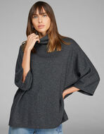 KNITTED PONCHO WITH LUREX THREADS