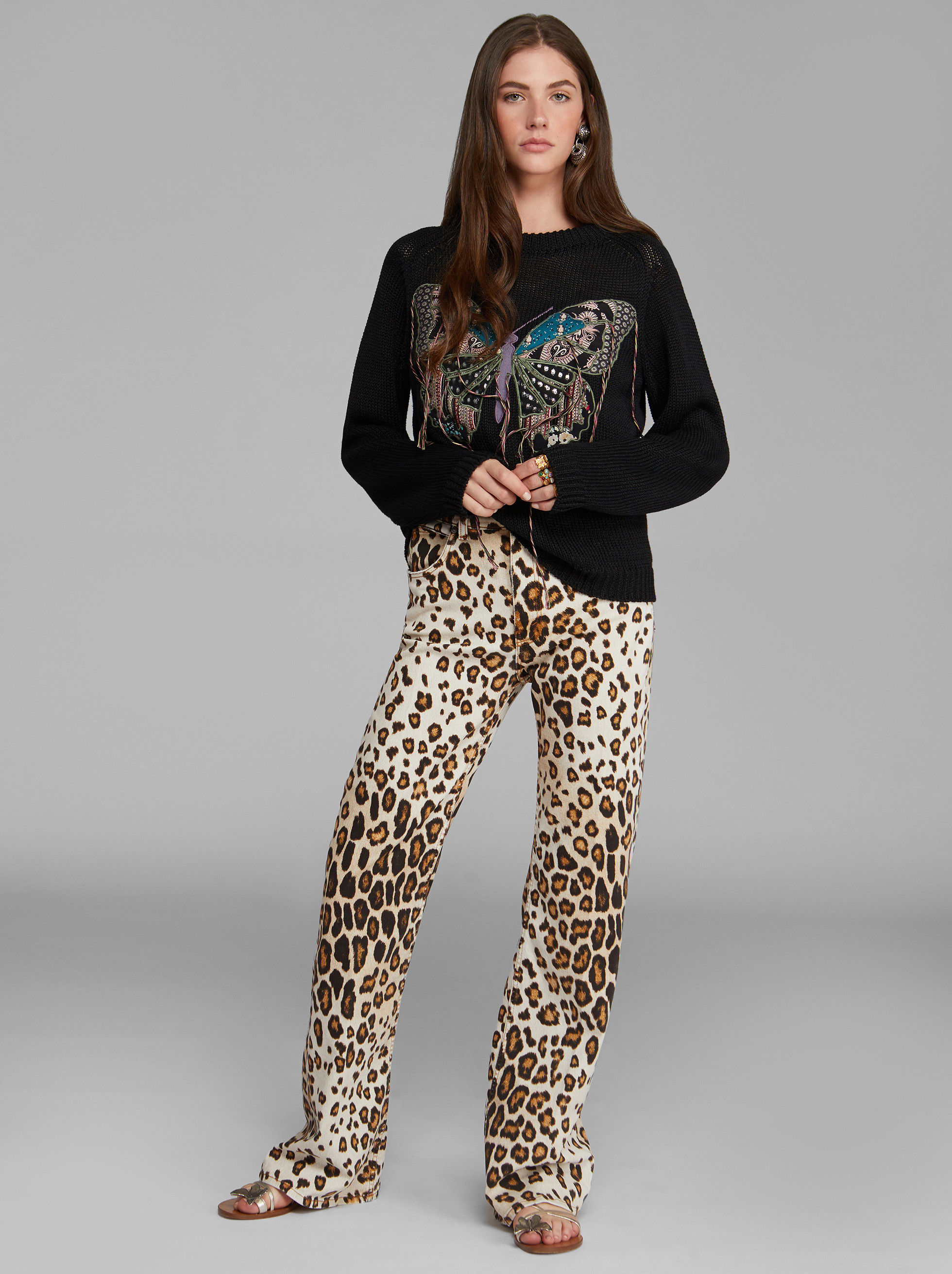 FLARED JEANS WITH ANIMAL PRINT
