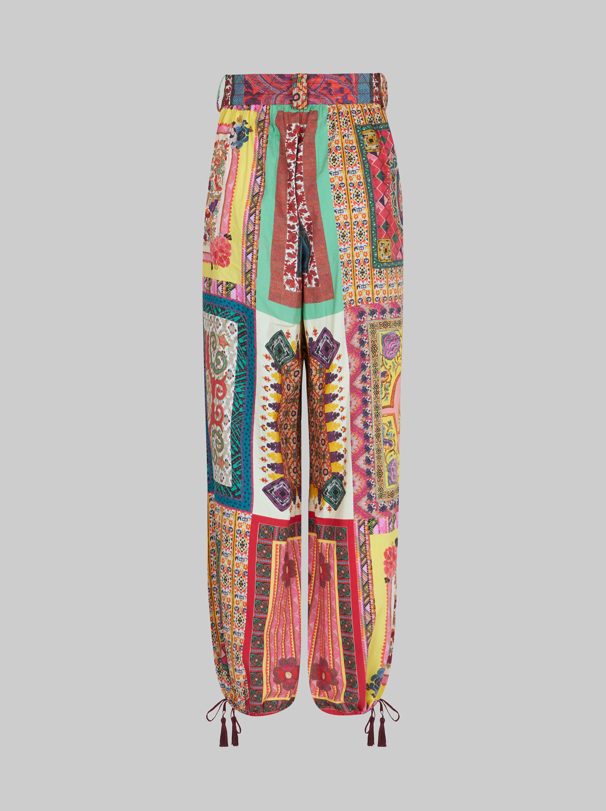 PATCHWORK PRINT TROUSERS WITH TASSELS