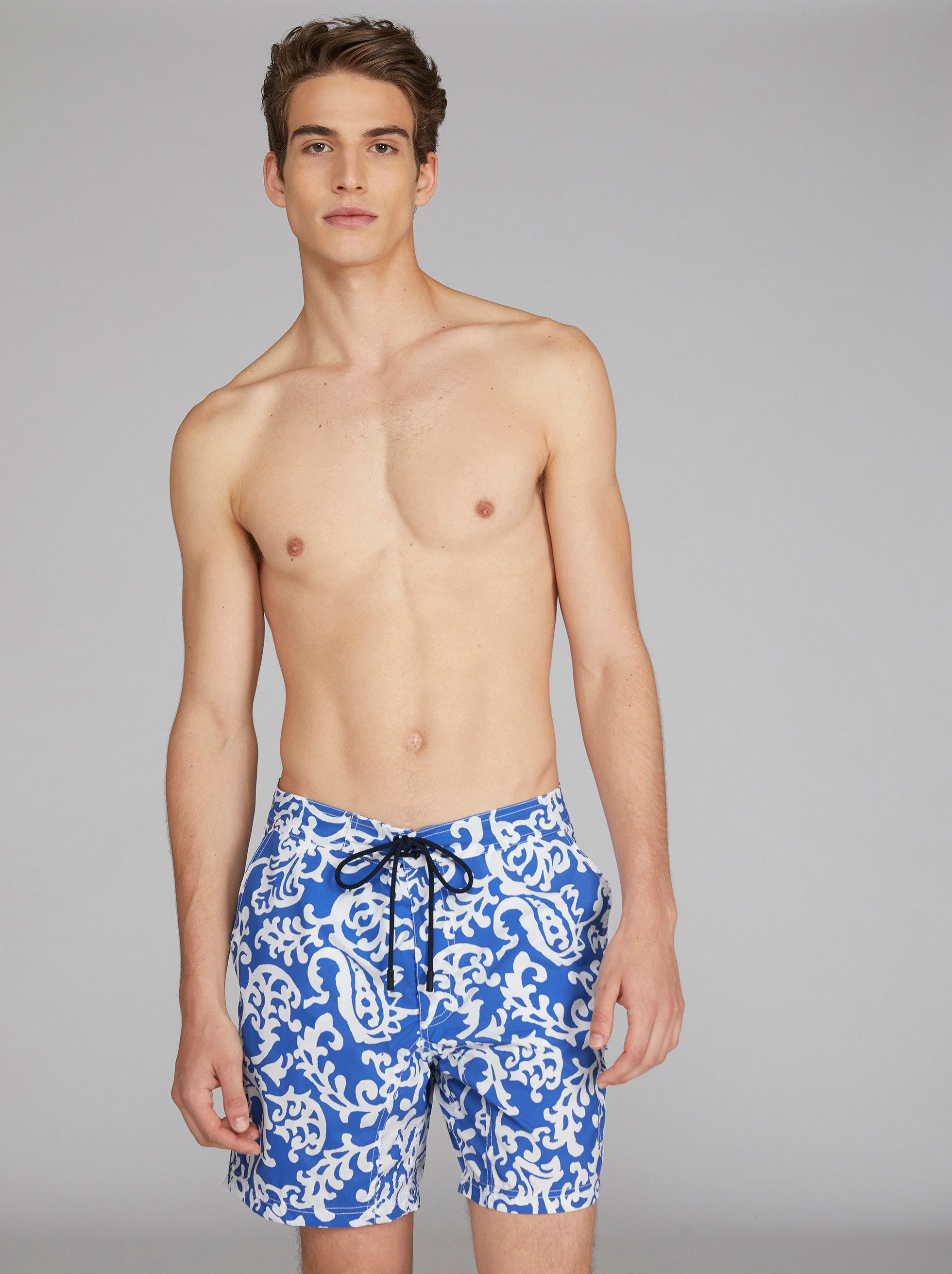 FOLIAGE PATTERN SWIM SHORTS