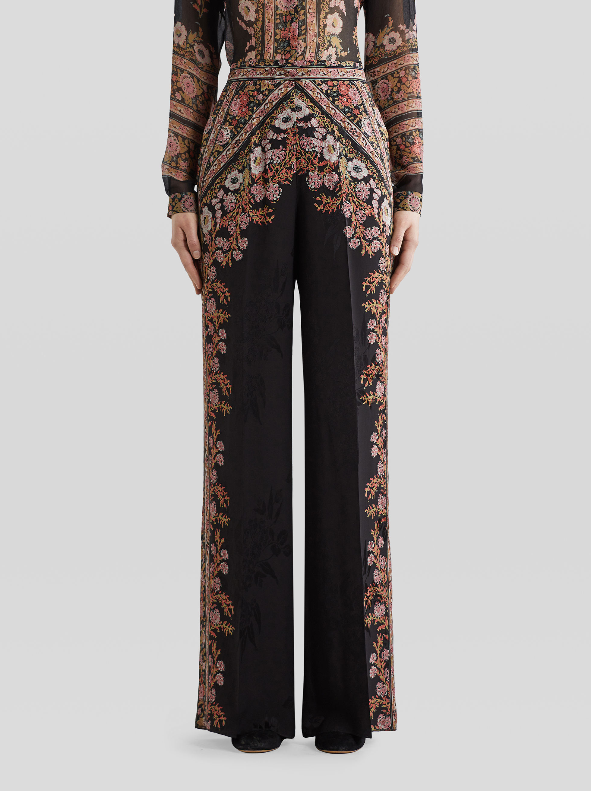 PALAZZO TROUSERS WITH PRINTED FLOWERS AND TAPES